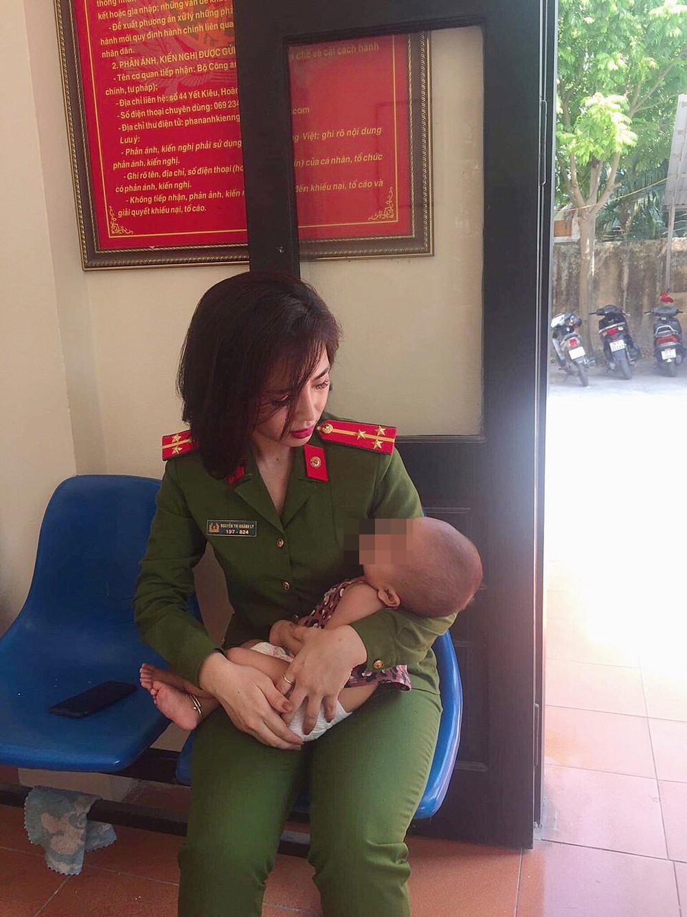 Hình ảnh đời thường xinh đẹp của nữ cảnh sát trong vụ giải cứu ông bố ôm con định nhảy cầu Nhật Tân - Ảnh 1.