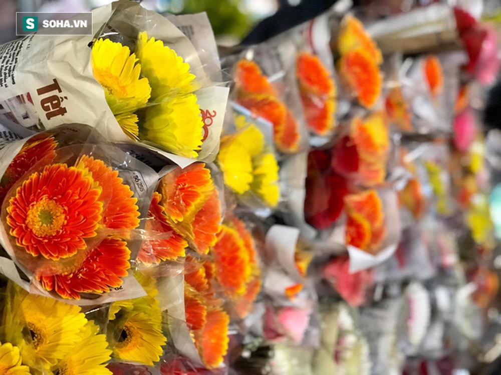 Doanh thu giảm 80%, tiểu thương chợ hoa Quảng An chỉ dám nhập cầm chừng - Ảnh 10.