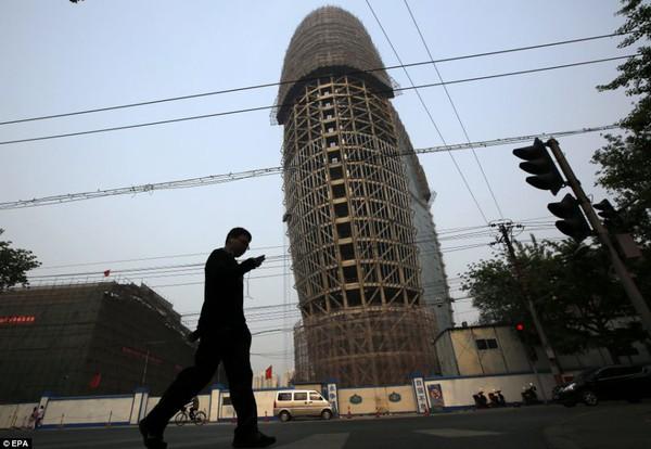 """Trụ sở mới của Nhân dân nhật báo ở Bắc Kinh có cấu trúc hình """"của quý khổng lồ"""""""