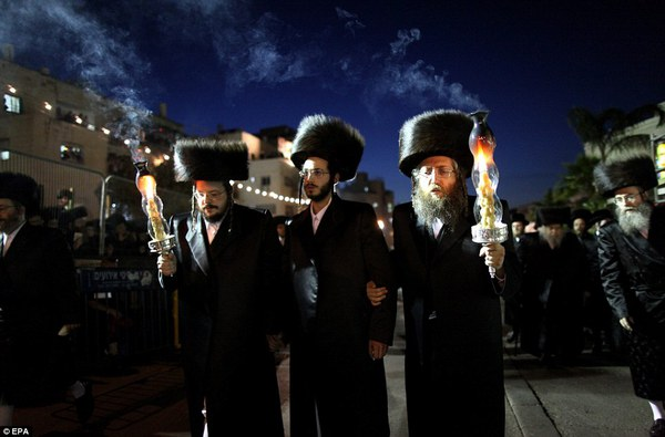 Future leader: The groom Shalom Rokeach, 18, pictured centre, is the grandson of the head of one of the largest hasisic communities in Jerusalem, Beltz Rebbe, and is expected to take his place one day