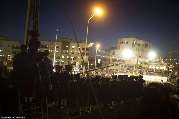Well-wishers: Tens of thousands of Ultra-Orthodox Jews of the Belz Hasidic Dynasty watch the wedding ceremony of Rabbi Shalom Rokach