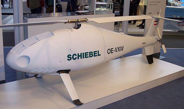Được phát triển bởi công ty Schiebel của Áo từ năm 2003 đến 2005, trực thăng không người lái Camcopter S-100 có độ linh hoạt và tin cậy cao, tích hợp những công nghệ tiên tiến giúp cho máy bay có hiệu suất và tính năng kĩ chiến thuật cao so với các máy bay cùng loại.