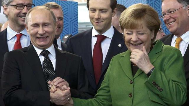Tổng thống Nga Putin và Thủ tướng Đức Merkel.