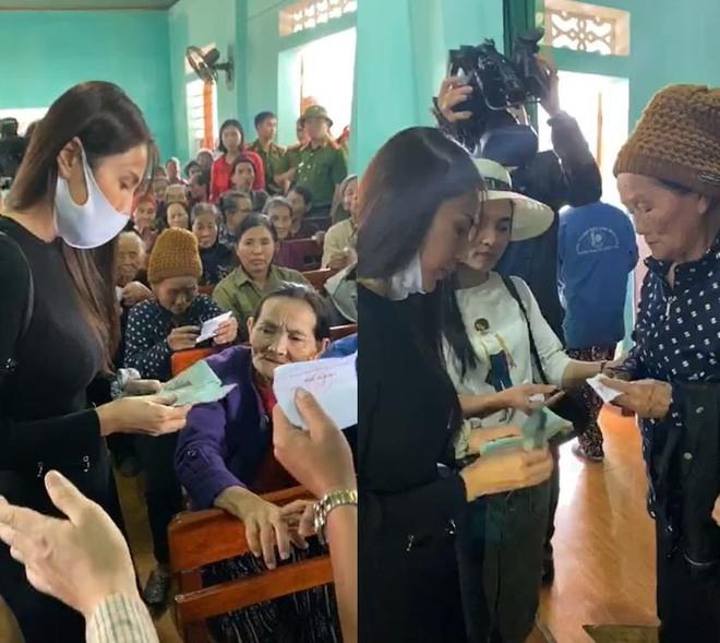 Vợ chồng ca sỹ Thủy Tiên - Công Vinh về vùng rốn lũ tại Hà Tĩnh trực tiếp trao tiền cho người dân - Ảnh 2.