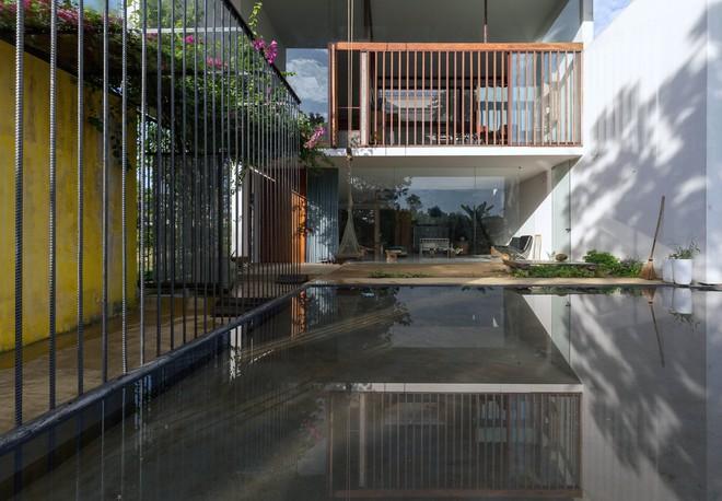 Huế: Căn nhà mới hoàn thiện 1/2, tận dụng gỗ thừa, vật liệu cũ bất ngờ được lên báo Mỹ - Ảnh 16.