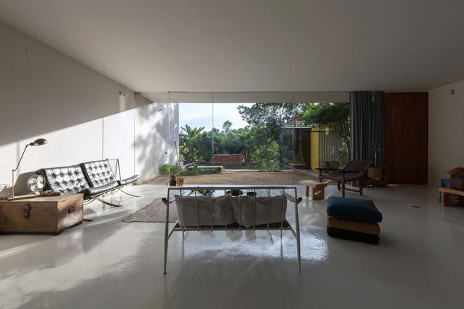 Huế: Căn nhà mới hoàn thiện 1/2, tận dụng gỗ thừa, vật liệu cũ bất ngờ được lên báo Mỹ - Ảnh 1.