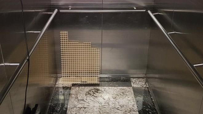 Hiện trường vụ rơi thang máy khiến nhiều người bị thương ở Hà Nội - Ảnh 12.