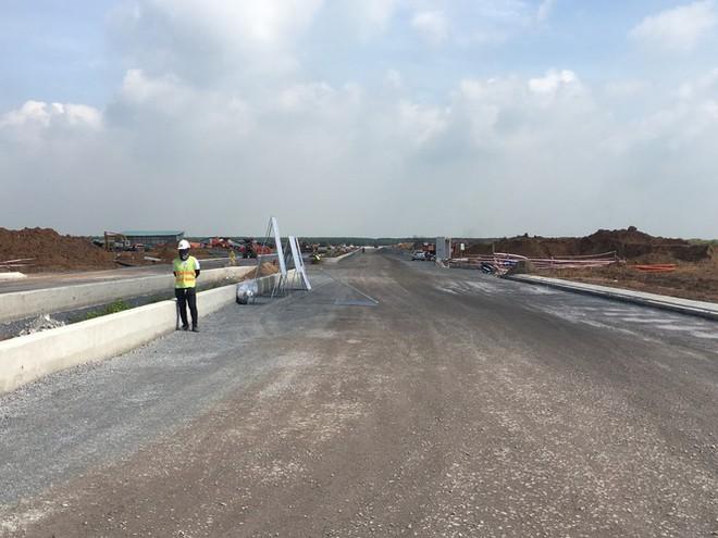 Những hộ dân đầu tiên ở vùng dự án sân bay Long Thành nhận đất tái định cư - Ảnh 1.