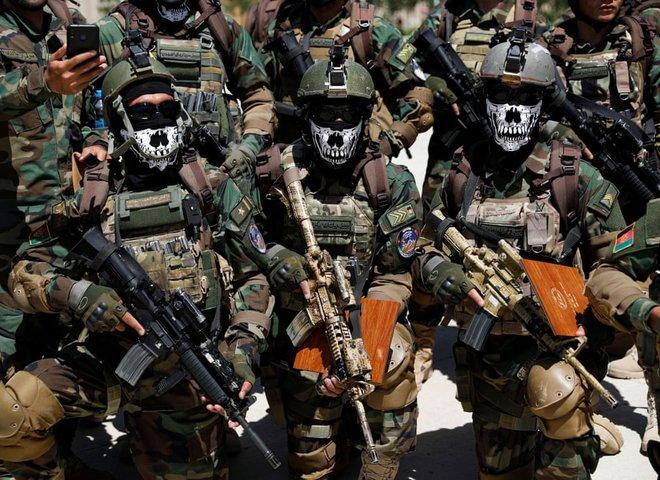 24h qua ảnh: Lính đặc nhiệm Afghanistan tham dự lễ tốt nghiệp - Ảnh 2.
