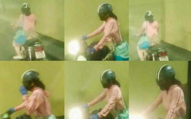Cô gái trẻ điều khiển xe máy, vượt các chốt chặn để chạy xuyên hầm Hải Vân. Ảnh: chụp lại clip.