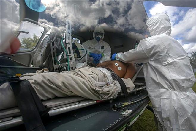 COVID-19 tới 6 giờ sáng 2/7: Số ca tử vong tăng vọt trở lại ở Mỹ, Brazil - Ảnh 6.