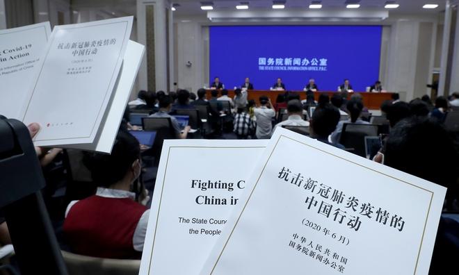 WHO sửa thông tin, nói phát hiện Covid-19 nhờ... tự đọc, 2 lần nhắc Trung Quốc báo cáo: Bắc Kinh nói gì? - Ảnh 2.