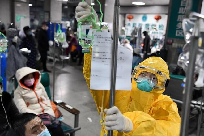 Cuộc sống lao đao của người dân Vũ Hán nửa đầu năm 2020: Dịch bệnh nguôi ngoai không bao lâu đã phải oằn mình chống lũ - Ảnh 12.