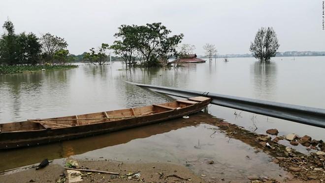 Lũ lụt ảnh hưởng như thế nào tới kinh tế TQ: Vụ mùa năm nay gia đình tôi mất trắng rồi!  - Ảnh 1.