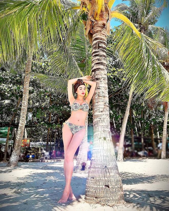 Hoa hậu Diễm Hương tung loạt ảnh bikini nóng bỏng - Ảnh 1.