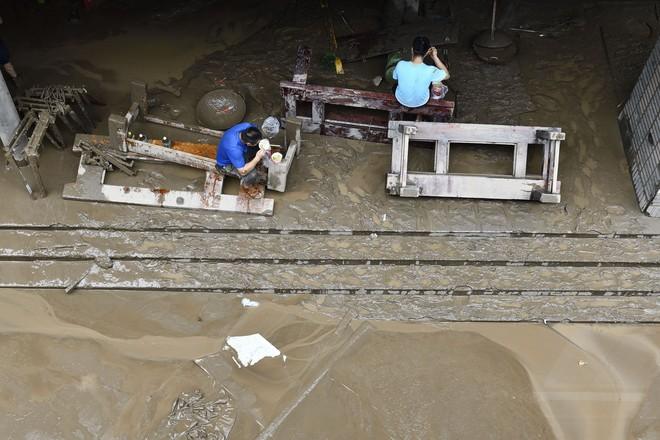 Trữ lượng hồ chứa đập Tam Hiệp gấp 2.000 lần trữ lượng nước Tây Hồ, người Trùng Khánh vất vả thu dọn tàn tích - Ảnh 12.