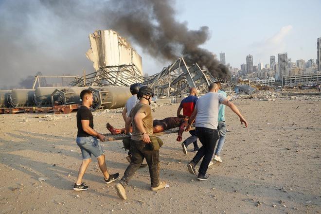 Hình ảnh nổ kinh hoàng như ngày tận thế: Sóng xung kích xé toạc cả Beirut trong vài giây - Ảnh 13.