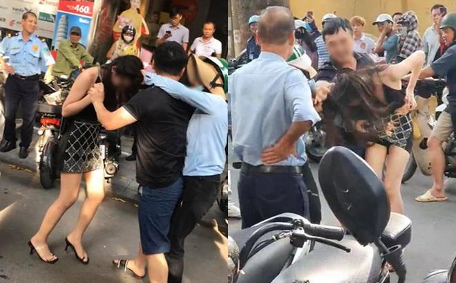 Vụ đánh ghen trên phố Lý Nam Đế: Sau xô xát, người vợ lấy xe Lexus bỏ đi, chồng đưa cô gái trẻ đi taxi