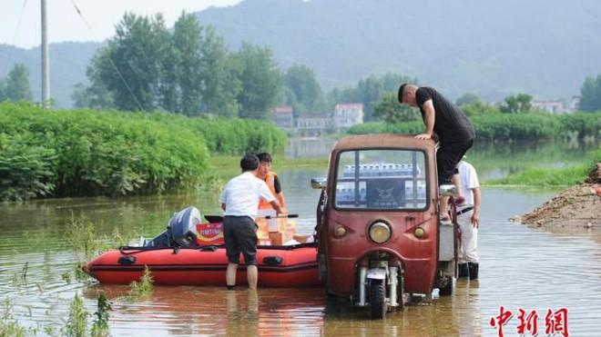 Trung Quốc: Gần 55 triệu lượt người chịu ảnh hưởng của lũ lụt - Ảnh 1.