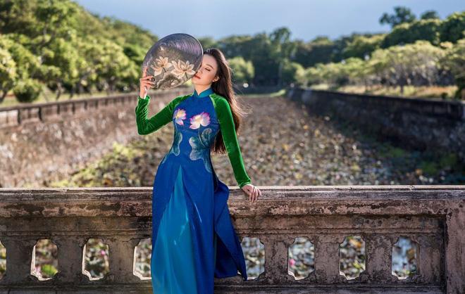 Mỹ nhân có mái tóc đẹp nhất Hoa hậu Việt Nam 2016 duyên dáng trong tà áo dài - Ảnh 6.
