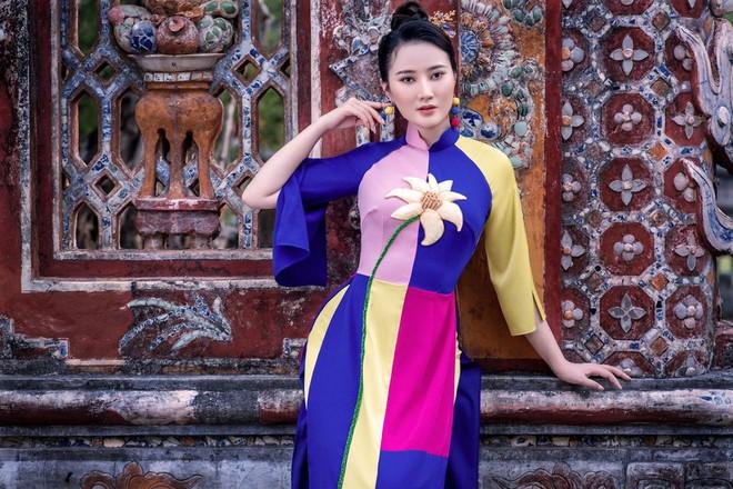 Mỹ nhân có mái tóc đẹp nhất Hoa hậu Việt Nam 2016 duyên dáng trong tà áo dài - Ảnh 3.