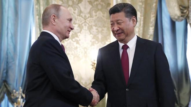 Phó giáo sư Nga vẽ đường cho ông Biden: Muốn cứu Mỹ hãy buông tha Nga, kiềm chế Trung Quốc - Ảnh 2.