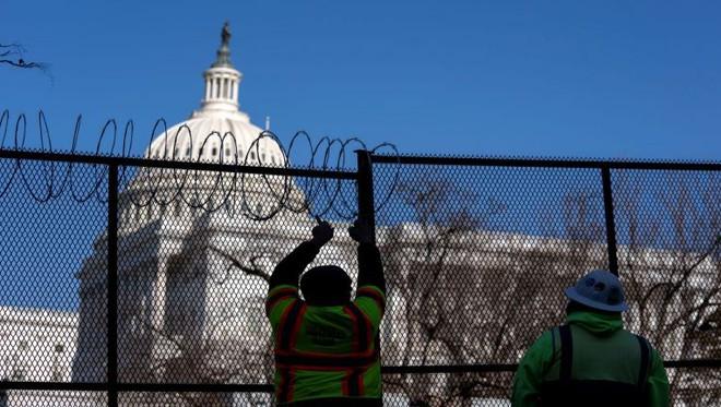 Diễn tập lễ nhậm chức của ông Biden bị hoãn, Washington chuẩn bị cho điều tồi tệ nhất - Ảnh 3.