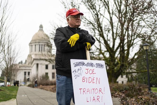 Người ủng hộ ông Trump dọa làm loạn lễ nhậm chức, vì sao đến ngày lại mất hút? - Ảnh 3.