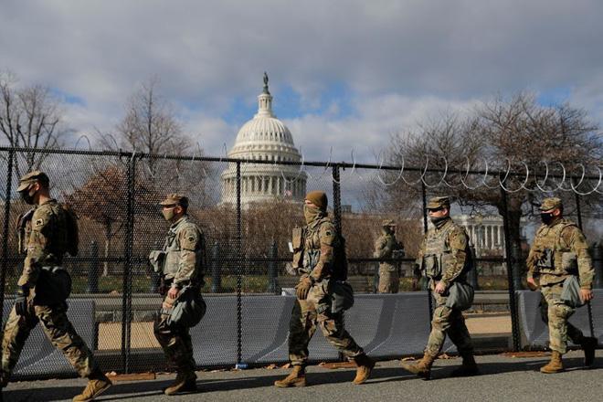 Nước Mỹ đã có cuộc chuyển giao quyền lực hoà bình, nhưng đất nước có trở lại như xưa? - Ảnh 3.
