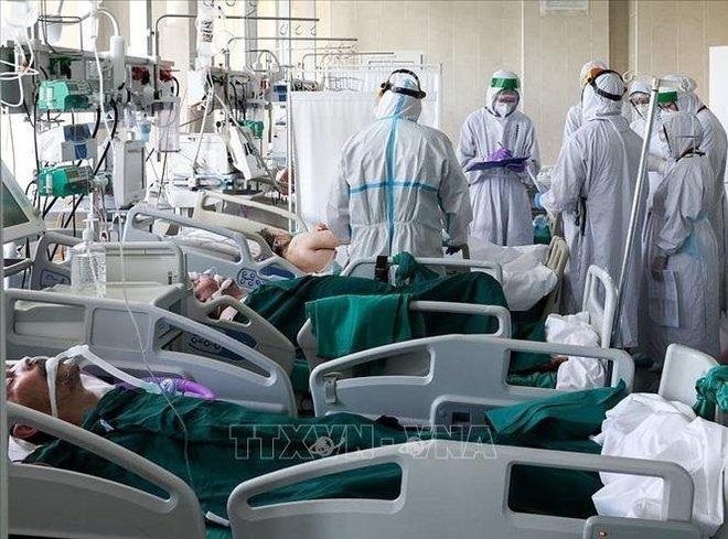 Vaccine AstraZenecca đạt hiệu quả cao nhất khi nào? - Tình hình COVID-19 tại Nga diễn biến xấu, TT Putin ra chỉ thị nóng - Ảnh 1.