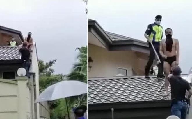 Đi ăn trộm bị chó đuổi sợ chết khiếp, gã đàn ông nhảy tót lên mái nhà, không ai nhịn được cười khi thấy bộ dạng của hắn lúc bị bắt