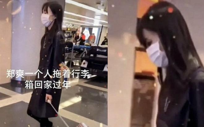Xôn xao hình ảnh Trịnh Sảng lộ diện sau scandal: Cúi gằm mặt, mệt mỏi kéo vali một mình về quê ăn Tết?