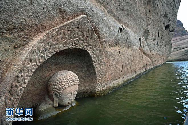 Hạn hán nghiêm trọng khiến hồ chứa cạn nước, lộ ra đầu tượng Phật khổng lồ: Bí mật vẫn còn nằm bên dưới - Ảnh 5.