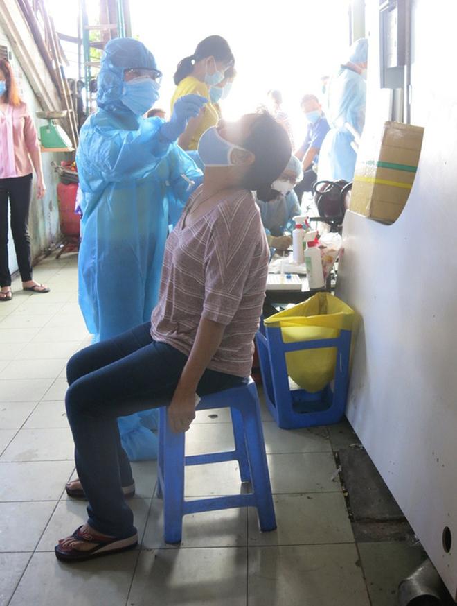 98% người dân Việt Nam đồng ý tiêm vắc xin Covid-19 - Ảnh 1.