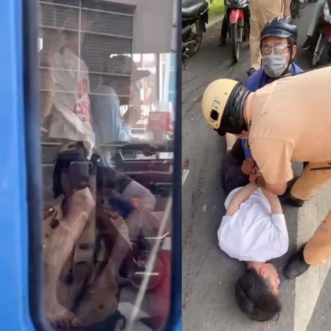 CSGT TP HCM dùng súng khống chế nam thanh niên gí dao vào cổ tài xế xe buýt - Ảnh 2.