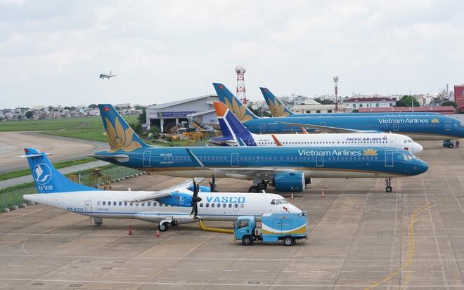 Vietnam Airlines: Lỗ hơn 11.000 tỷ, Ban lãnh đạo nhận thù lao 6,5 tỷ đồng - Ảnh 3.