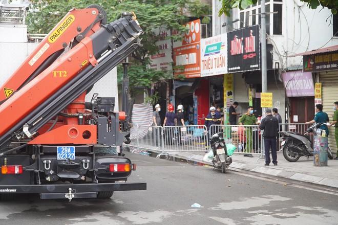 [ẢNH] Hiện trường vụ cháy cửa hàng bán đồ trẻ em khiến 4 người trong gia đình tử vong - Ảnh 1.