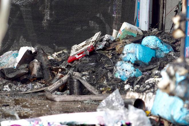 [ẢNH] Hiện trường vụ cháy cửa hàng bán đồ trẻ em khiến 4 người trong gia đình tử vong - Ảnh 4.