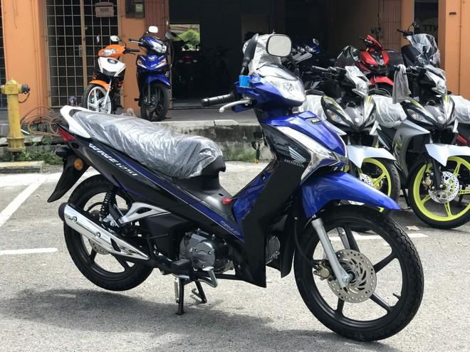 Giải mã cơn sốt xe Wave Thái: Đầy bình xăng đi 350km, giá 39 triệu đồng - Ảnh 11.