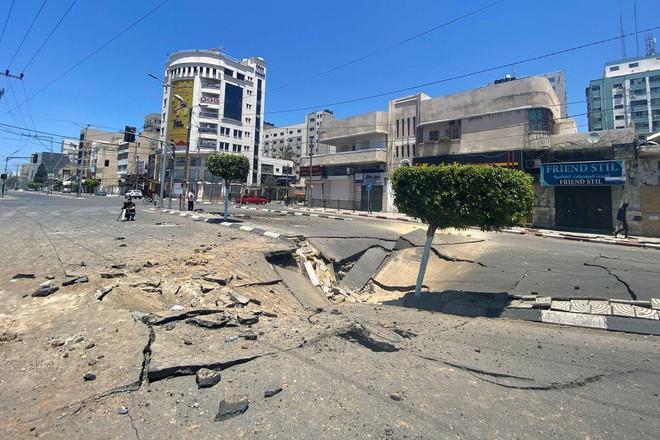 Khoảnh khắc quân đội Israel gọi điện cho cư dân Gaza cảnh báo sắp đánh sập tòa nhà 13 tầng - Ảnh 3.