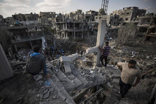 Khoảnh khắc quân đội Israel gọi điện cho cư dân Gaza cảnh báo sắp đánh sập tòa nhà 13 tầng - Ảnh 6.