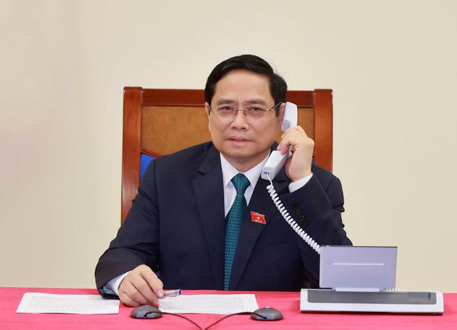 Thủ tướng Việt Nam đề nghị Nhật Bản sớm chuyển giao công nghệ vaccine Covid-19 - Ảnh 1.