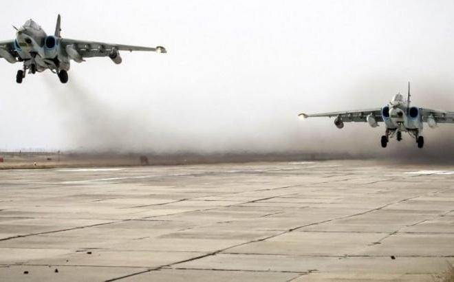 """Nga tăng cường không kích vùi IS trong """"biển máu"""""""
