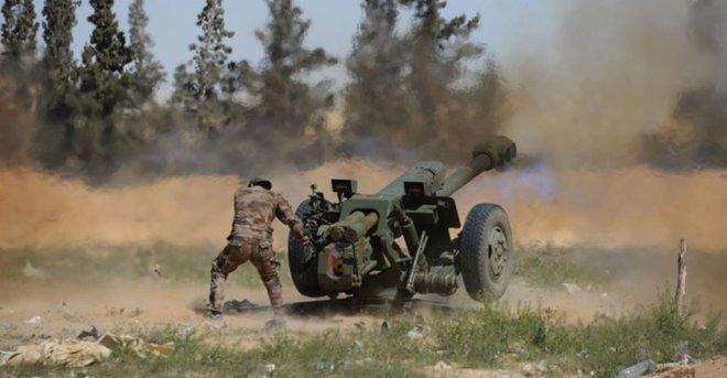 Chiến trường Syria: Đấu súng tàn khốc và cuộc chiến giành giật căn cứ - Ảnh 2.