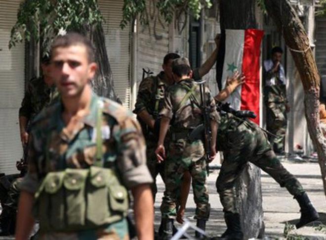 Quân chính phủ Syria thi bắn tỉa vào thai nhi trong bụng mẹ