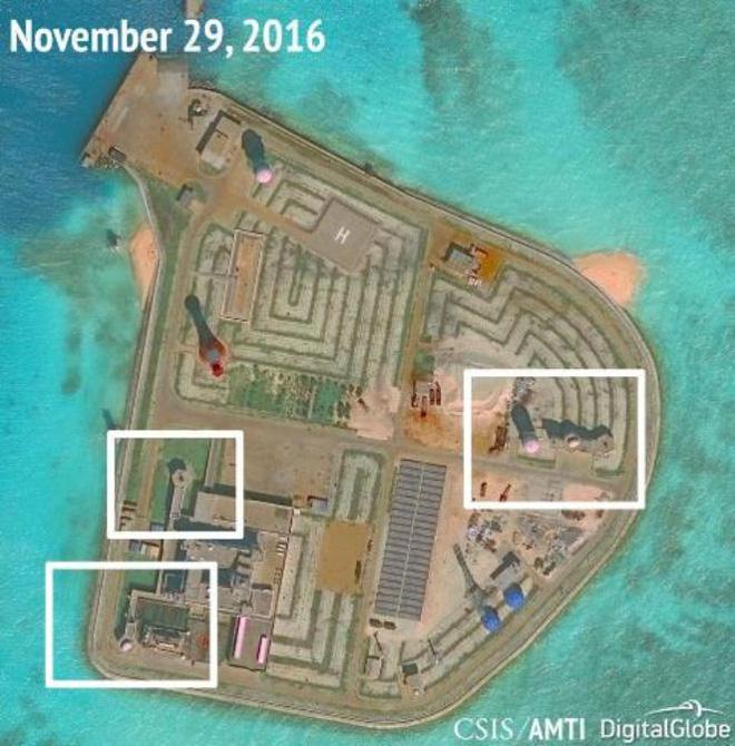 Việt Nam phản đối Trung Quốc triển khai vũ khí lên 7 đảo nhân tạo ở Biển Đông - Ảnh 1.