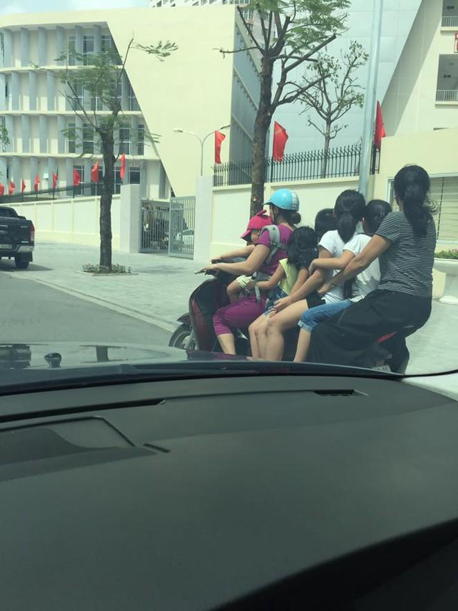 Hình ảnh người phụ nữ trên phố Hà Nội khiến cánh đàn ông tái mặt ái ngại - Ảnh 2.