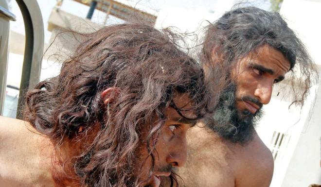 Sau giao tranh, người dân Iraq – Syria đau đầu nghĩ cách xử lí hàng nghìn xác lính IS - Ảnh 1.