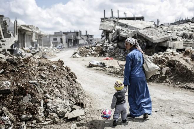 Giải phóng Aleppo, Syria đối diện bài toán hóc búa nhất: Số phận Assad thế nào? - Ảnh 1.