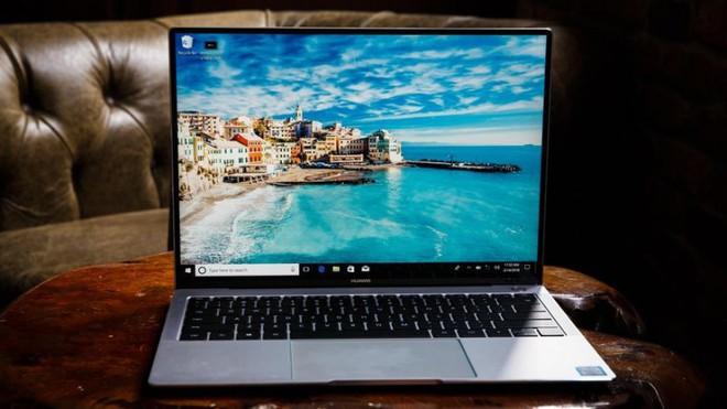 Apple sẽ ra mắt một chiếc laptop bí ẩn tuần tới, đây là những gì chúng ta đã biết về nó - Ảnh 3.